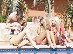 Three chicks in swimsuits turned on the guy by the pool