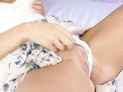 Teen brunette is having hot pleasure on the bed alone