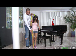 Teen brunette got fucked hard by strong dude near piano