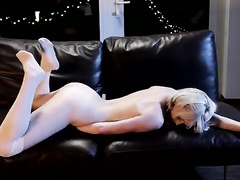 Smooth blonde enjoys masturbation on leather couch
