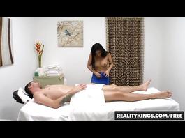 Horny masseuse Ember Snow does handjob and sucks big dick
