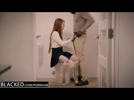 Ginger schoolgirl pleasantly fondles big black dick in the bathroom
