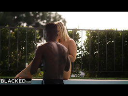 Blonde babe with sexy tits hotly kisses with black fucker in the pool