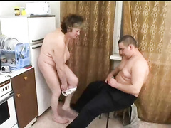 Fat young guy fucked mature lady in kitchen in doggy pose